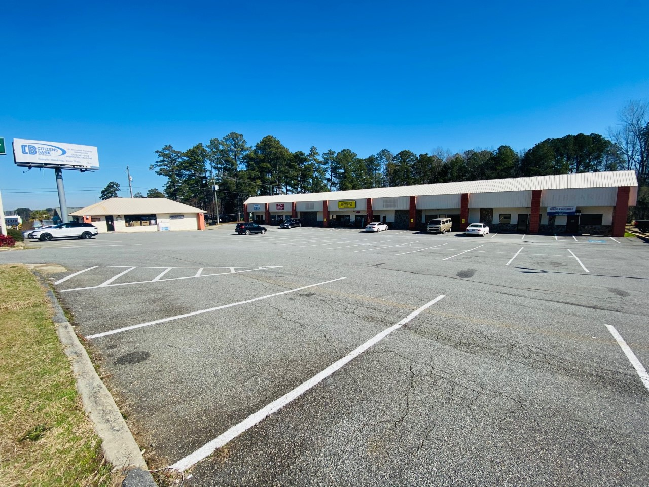 NEW LISTING! Milledgeville Strip Mall Property & Liquor Store Business